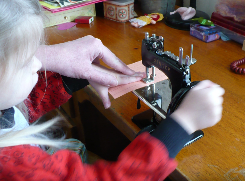 She sews with help
