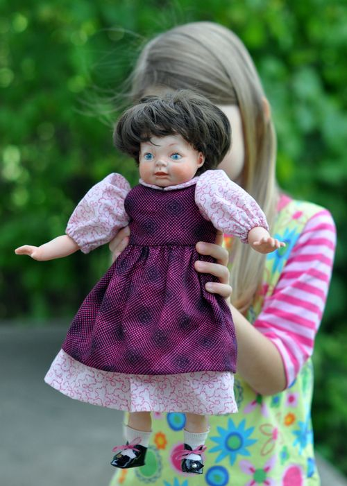 Doll dress and pinafore