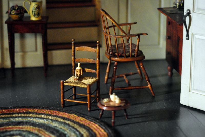 Miniature doll on chair