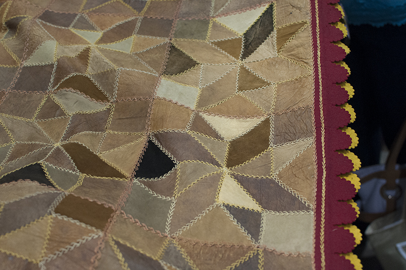 Antique leather quilt with felt edging
