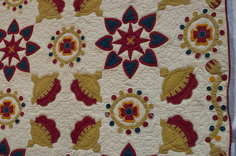 Antique applique with embroidery